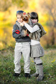 Portrait of little boy and girl outdoors in autumn — Stock Photo