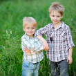 Foto Stock: Portrait of two brothers summer in country