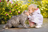 Portrait of a little girl with a cat — Stock Photo