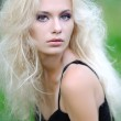 Portrait of a beautiful blonde girl outdoors in summer — Stock Photo