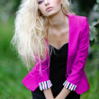 Portrait of a beautiful blonde girl in a pink jacket — Stock Photo