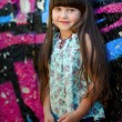 Portrait of little girl outdoors in colored shirt — Stockfoto #14926015