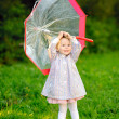 Stock Photo: Portrait of little girl with umbrella