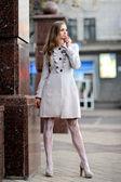 Portrait of a beautiful girl in a autumn coat — Stock Photo