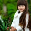 Portrait of little girl outdoors in style of gardener — Stock Photo #18335463