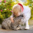 Portrait of little girl with cat — Stock Photo #18335481
