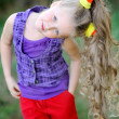 Stock Photo: Portrait of little girl outdoors in summer
