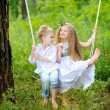 Portrait of little boys and girls outdoors in summer — Stock Photo #18335583