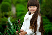 Portrait of little girl outdoors in the style of gardener — Stock Photo