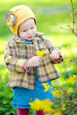 Portrait of little girl outdoors with forsythia — Stock Photo