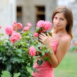 Portrait of a beautiful young girl with flowers — Stock Photo