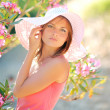 Portrait of a beautiful young girl with flowers  — Stockfoto