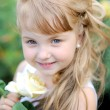 Portrait of a beautiful little girl in the summer — Stock Photo
