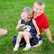 Portrait of little boy and girl outdoors — Stockfoto #28996483