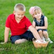 Stock Photo: Portrait of little boy and girl outdoors