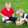 Portrait of little boy and girl outdoors — Stockfoto #28996669