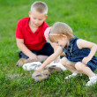 Foto Stock: Portrait of little boy and girl outdoors