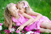 Portrait of two twins with peonies — Stok fotoğraf