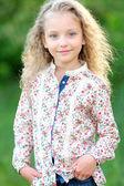 Portrait of little girl outdoors — Stock Photo