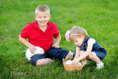 Portrait of little boy and girl outdoors — Stock Photo