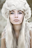 Portrait of a beautiful young girl in fur — Stock Photo
