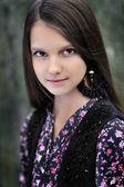 Portrait of a beautiful little brunette girl — Stock Photo