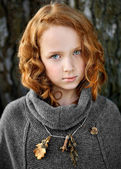 Portrait of a beautiful little redhead girl — Stock Photo