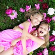 Portrait of two twins with peonies — Stock Photo #39093357