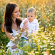 Portrait of mother and son in nature — Stock Photo