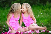 Portrait of two twins with peonies — Stock Photo