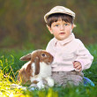 Portrait of a little boy with a rabbit — Stock Photo