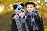 Portrait of a girl and boy in autumn — Stock fotografie