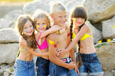 Portrait of children on the beach in summer — Stock Photo
