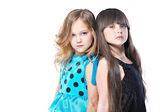 Portrait of two beautiful young girlfriends in studio — Stok fotoğraf