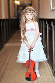 Portrait of a little girl with a violin — Stock Photo