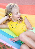 Portrait of little girl outdoors in summer — Stok fotoğraf