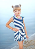 Portrait of little girl on a summer beach — Stock Photo