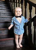 Portrait of a baby boy in a shirt at home — Stock Photo