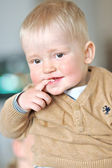 Portrait of a little boy in a sweater at home — Stock Photo