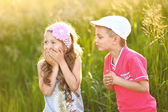 Portrait of a boy and girl in summer — Stock Photo