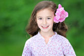 Portrait of a beautiful little girl with peony — Stockfoto
