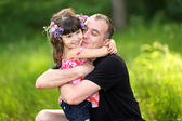 Portrait of a happy family in summer nature — Stockfoto