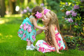 Portrait of two sisters in a park in spring — Stock Photo
