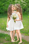 Portrait of two girls in the woods girlfriends — Stock Photo
