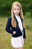 Portrait of little girl outdoors in summer — Foto de Stock