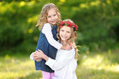 Portrait of two little sisters with berries — Stock Photo