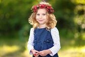 Portrait of a beautiful little girl with berries — Stock Photo