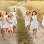 Portrait of little girls running on the field — Stock Photo #51035837