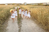Portrait of little girls running on the field — Stock Photo