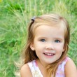Cute little girl on the meadow - Foto de Stock